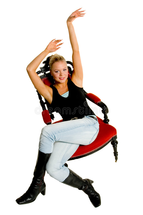 Woman relaxing on chair royalty free stock image
