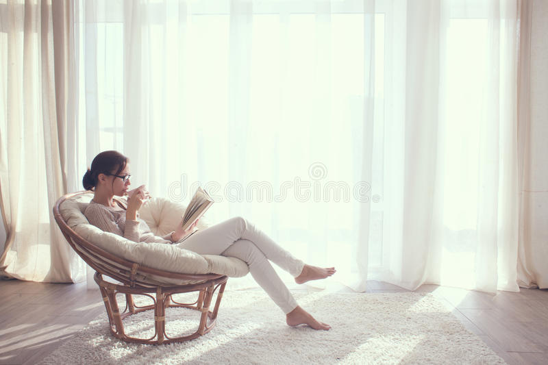 Download Woman relaxing in chair stock image. Image of apartment - 46039117