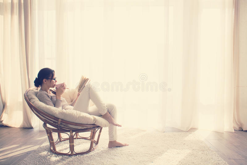 Woman relaxing in chair royalty free stock images