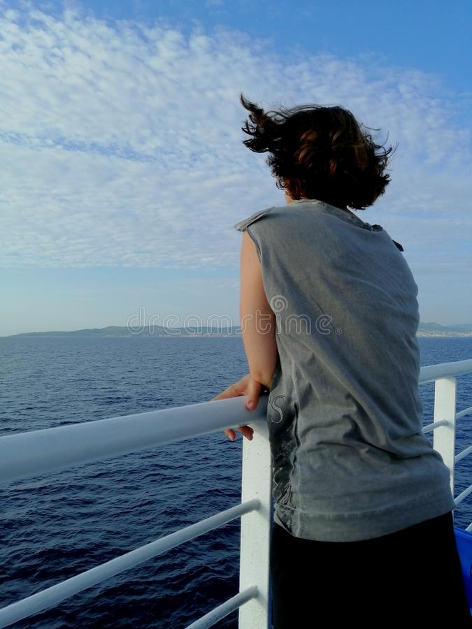 Woman relaxing on a cruise boat.  , wind stock image