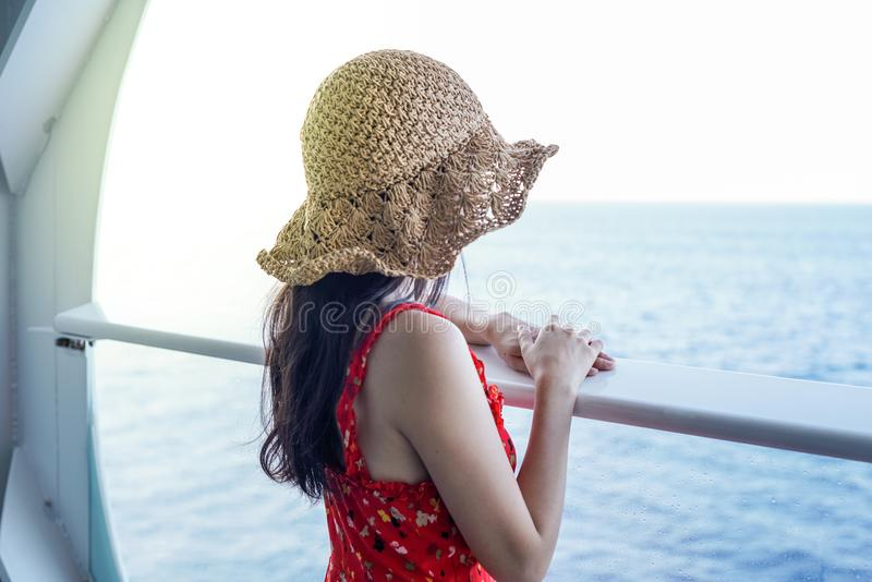 Woman relaxing on Cruise ship enjoying ocean view from balcony royalty free stock photos