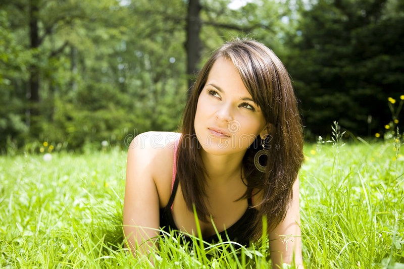 Woman relaxing in field royalty free stock images