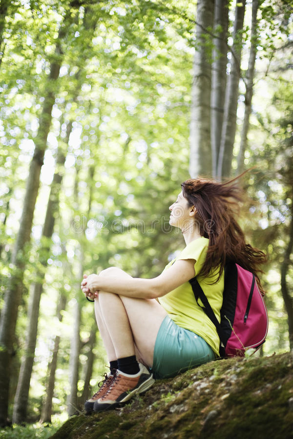 Woman relaxing in forest royalty free stock photos