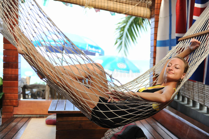 Woman relaxing in a hammock stock photography