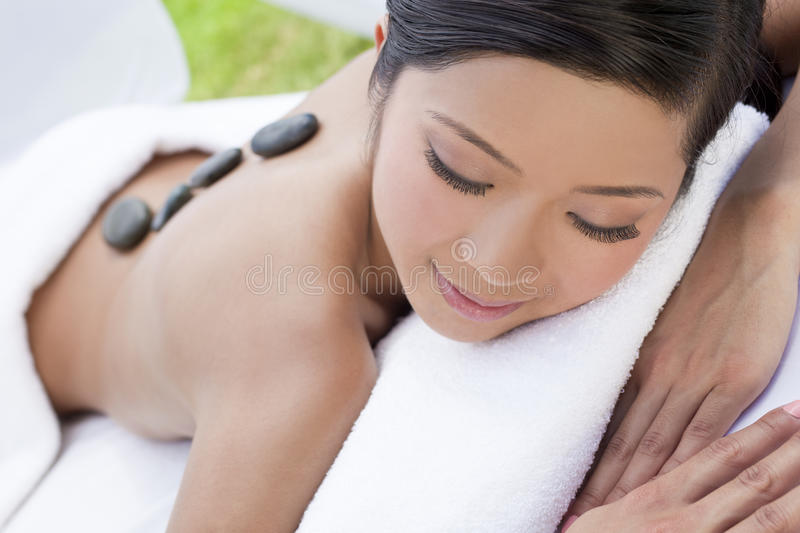 Woman Relaxing At Health Spa & Hot Stone Treatment royalty free stock image