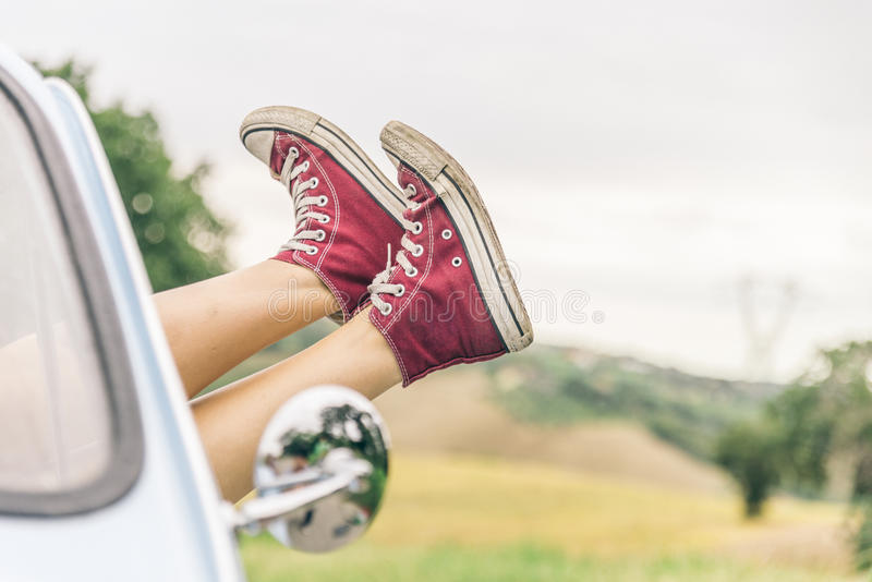 Woman relaxing in her car stock photos