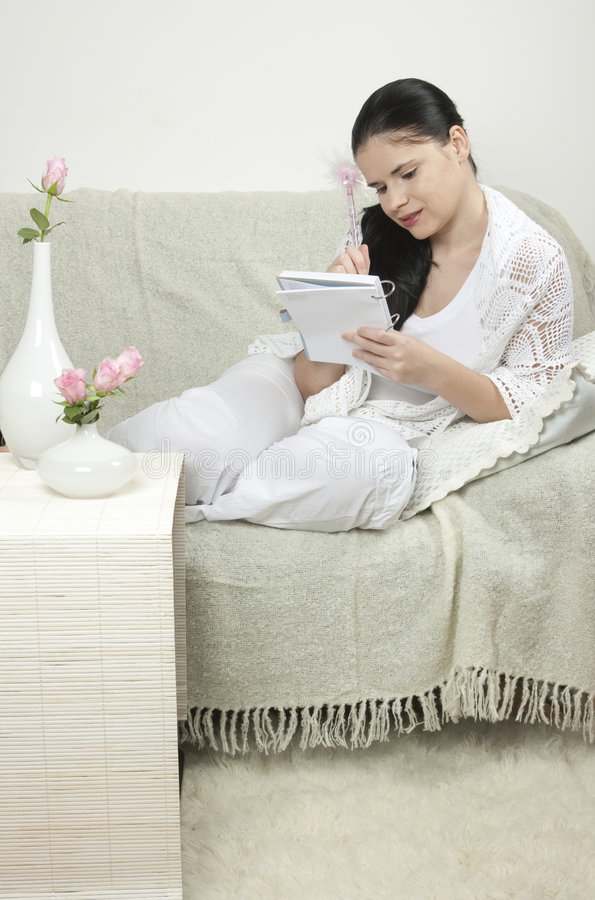 Woman relaxing at home stock image