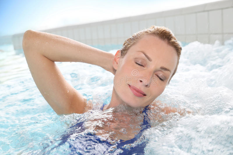 Woman relaxing in jacuzzi royalty free stock photos