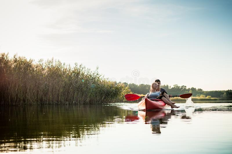 Woman relaxing in kayak with her boyfriend stock photos
