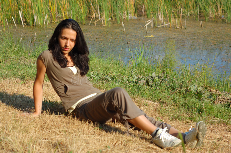 Download Woman relaxing by lake stock photo. Image of riverbank - 2798394
