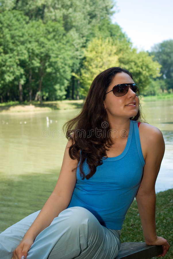 Download Woman relaxing by lake stock photo. Image of shades, female - 5616064