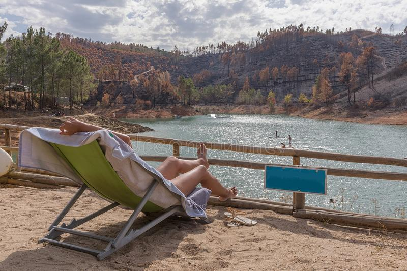 Woman relaxing by the lake. Nature in Portugal royalty free stock images