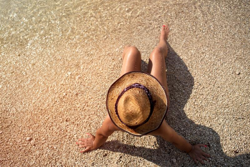 Young fashion woman relax on the beach royalty free stock images