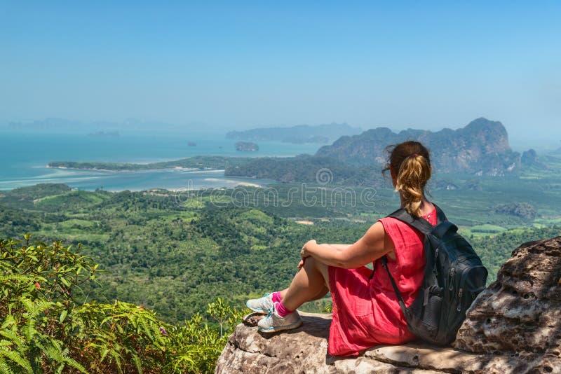 Woman relaxing at mountain top stock photos