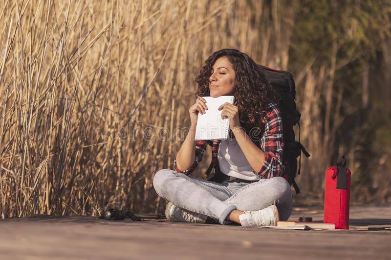 Woman relaxing in nature royalty free stock photo