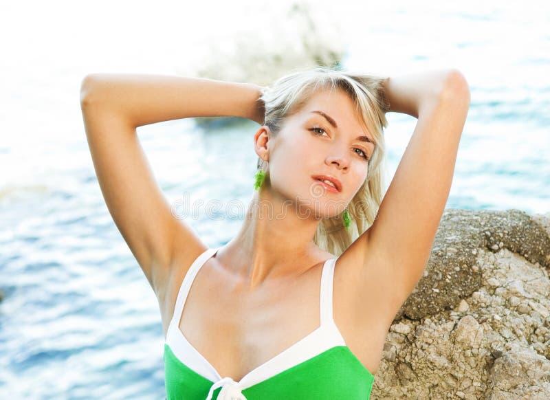 Woman relaxing near the ocean