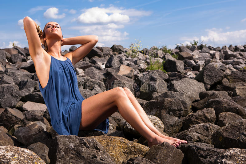 Woman relaxing by ocean stock photo