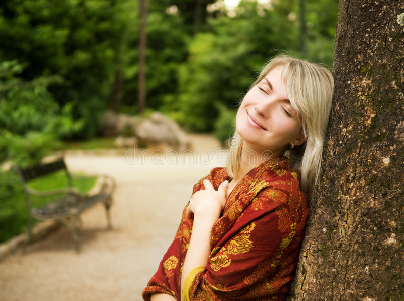 Download Woman relaxing in a park stock photo. Image of leaf, elegant - 6195782