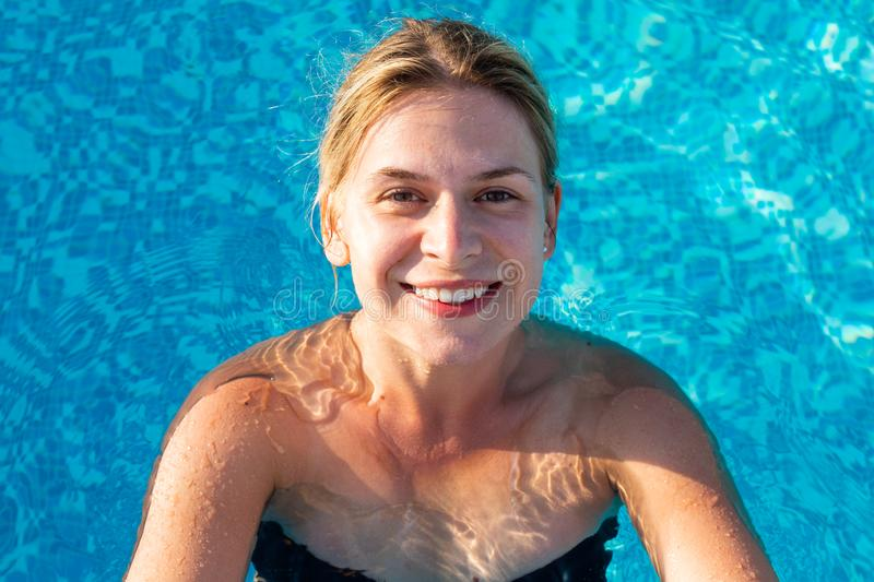 Woman relaxing at pool royalty free stock photo