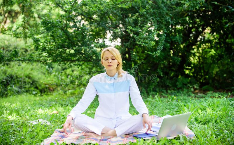 Woman relaxing practicing meditation. Reasons you should meditate every day. Find minute to relax. Clear your mind. Girl. Meditate on rug green grass meadow stock photos
