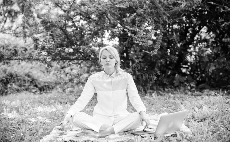 Woman relaxing practicing meditation. Reasons you should meditate every day. Find minute to relax. Clear your mind. Girl. Meditate on rug green grass meadow royalty free stock photo