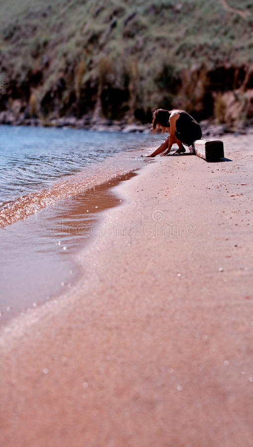 Download Woman Relaxing On Sandy Beach Stock Photo - Image: 26166886