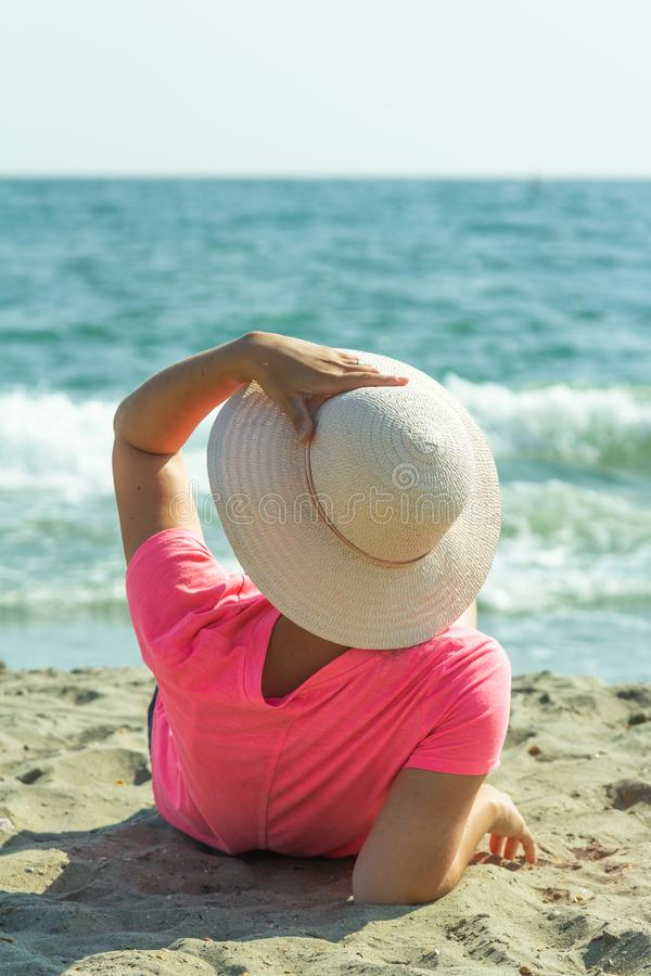 Woman relaxing on sandy beach stock photo