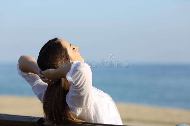 Download Woman Relaxing On A Bench On The Beach Stock Image - Image of head, healthy: 109159627