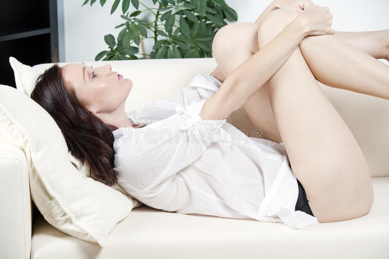 Download Woman relaxing on sofa stock photo. Image of woman, resting - 24619456