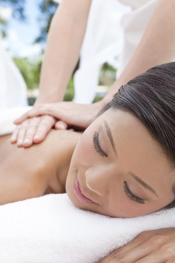 Woman Relaxing At Spa Having Outdoor Massage royalty free stock photo