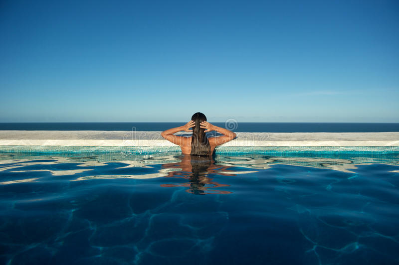 Woman relaxing in the spa swimming pool stock images