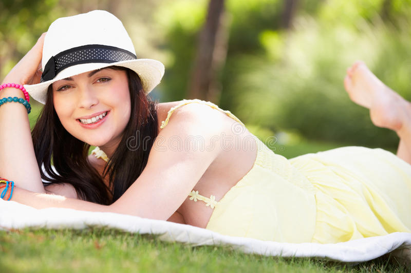 Download Woman Relaxing In Summer Garden Stock Photo - Image: 26615322