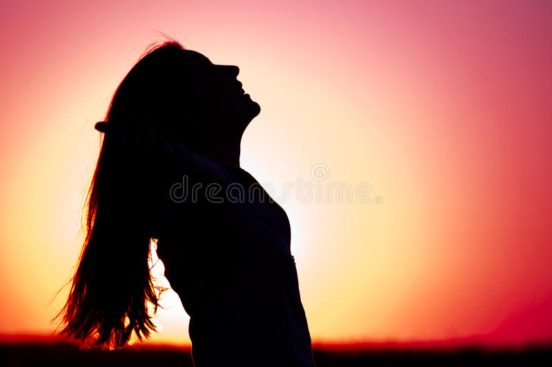 Woman relaxing at sunset royalty free stock photography