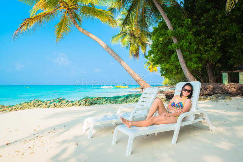 Woman is relaxing on the tropical beach royalty free stock photos