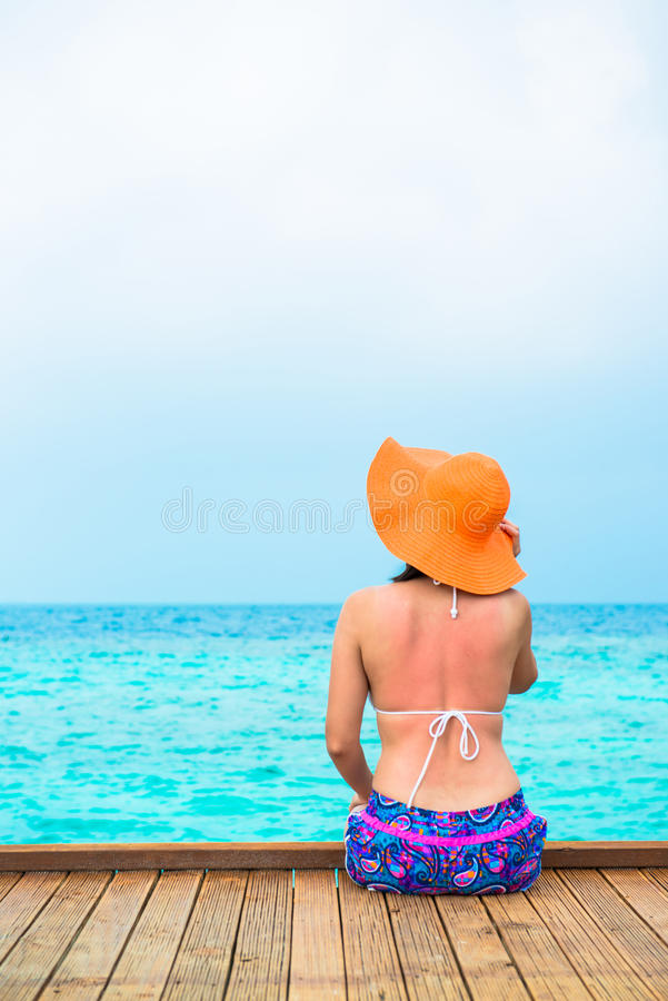 Woman is relaxing on the tropical beach stock photos