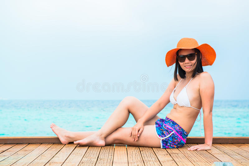 Woman is relaxing on the tropical beach stock photography