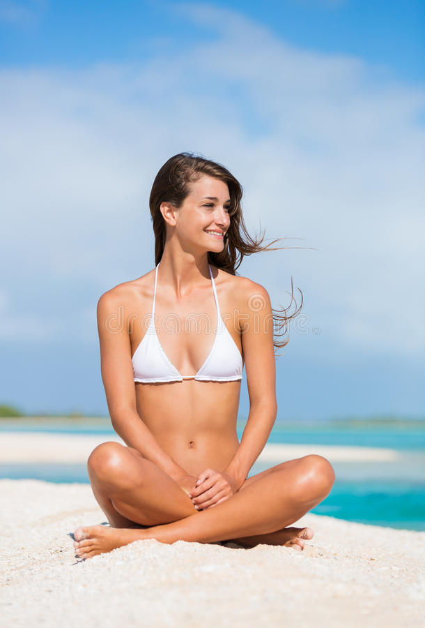 Woman Relaxing on Tropical Island stock photo