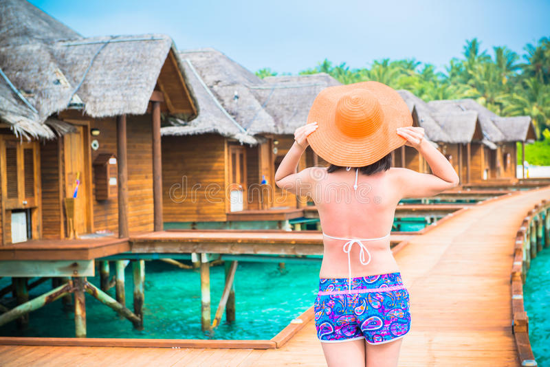 Woman is relaxing on the water bungalow of the tropical beach stock photos