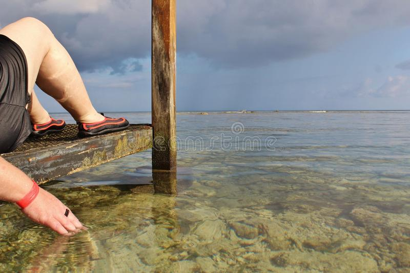 Woman relaxing in a waterfront cabana royalty free stock photo