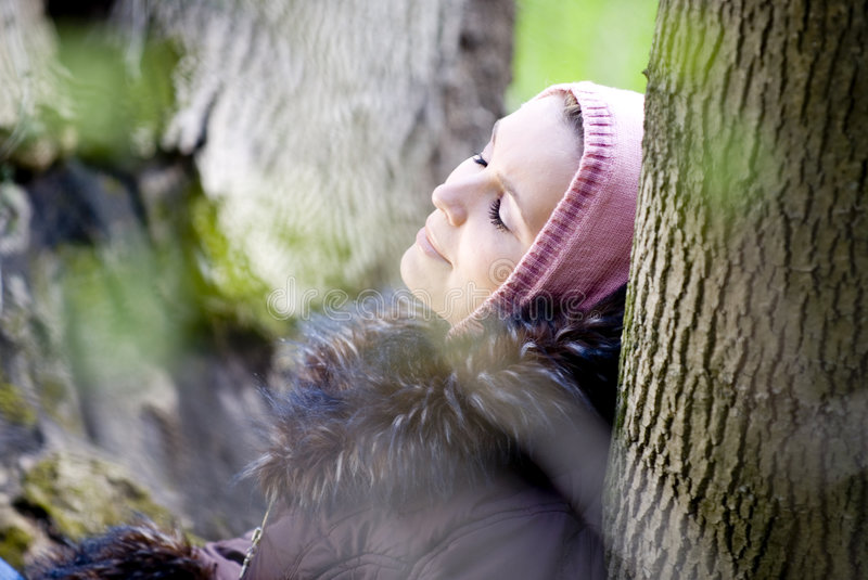 Woman Relaxing In Woods stock photo