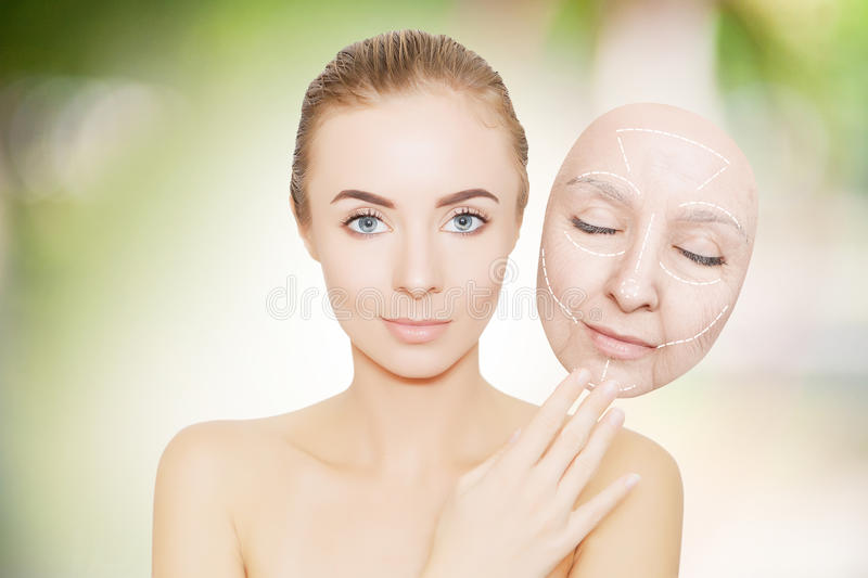 woman releases her face from wrinkles stock images