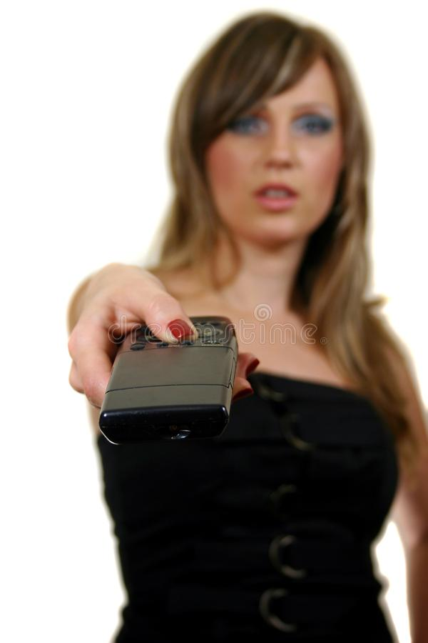 Woman with a remote control royalty free stock image
