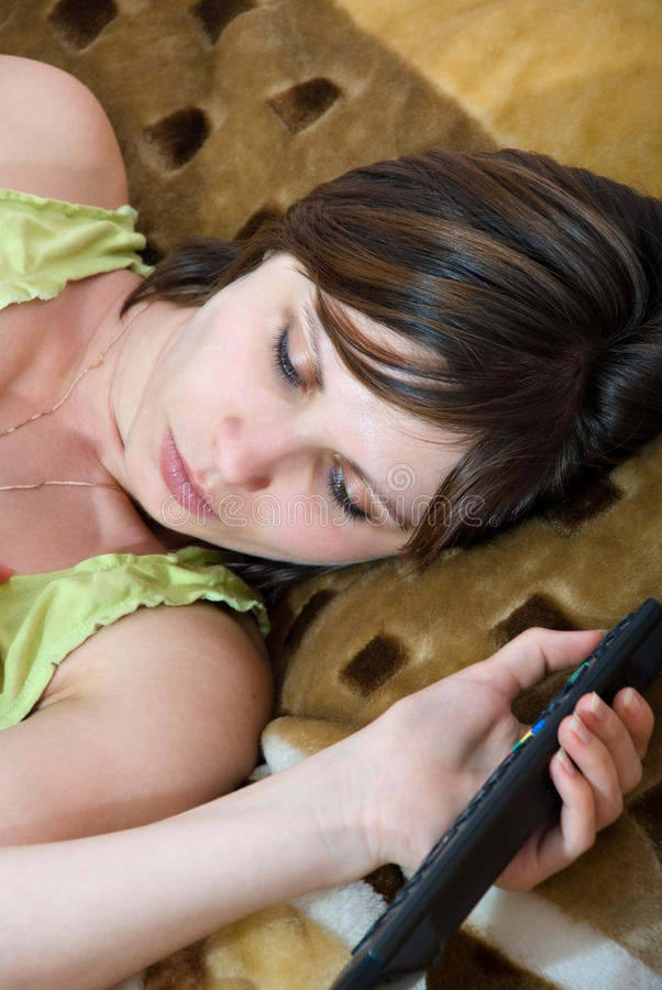 Download Woman With Remote Control In Hand Royalty Free Stock Image - Image: 21009026