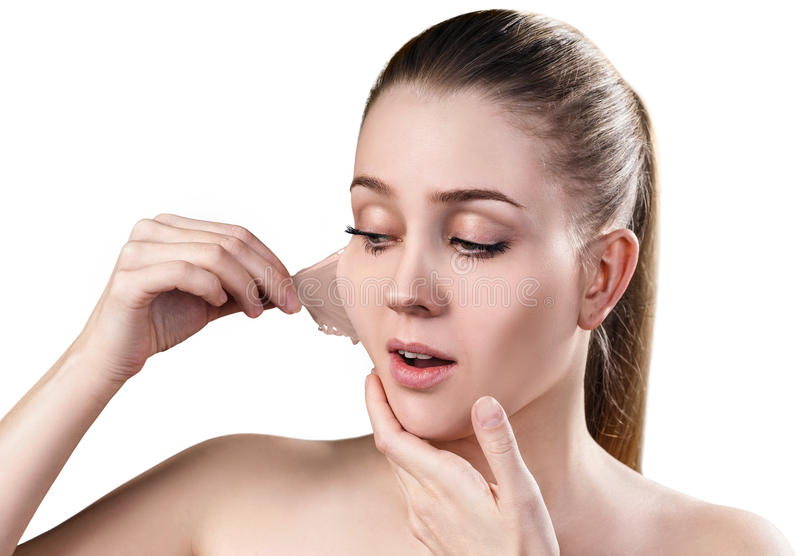 Woman remove her old dry skin from face. royalty free stock images