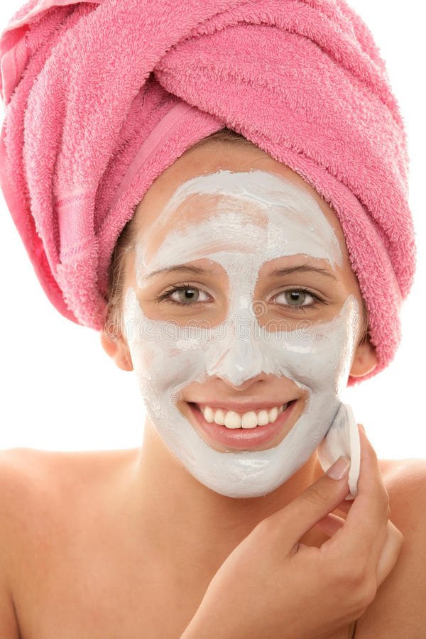 Woman removing facial mask royalty free stock images