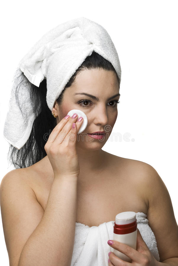 Woman removing make up stock image