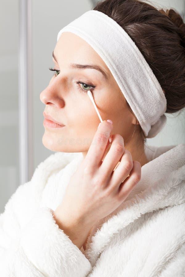 Woman removing make-up royalty free stock photo