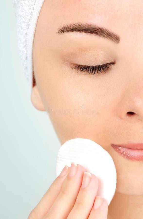 Woman removing makeup royalty free stock photos