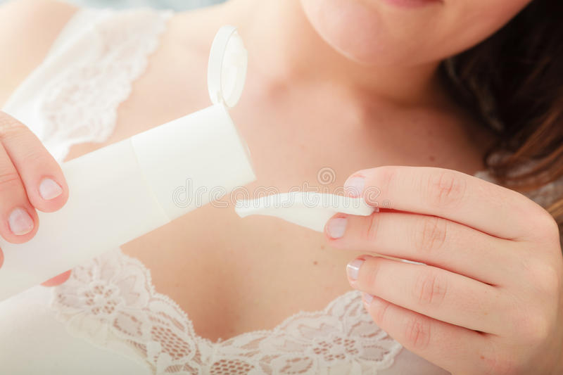 Woman removing makeup with cotton swab pad. royalty free stock photography