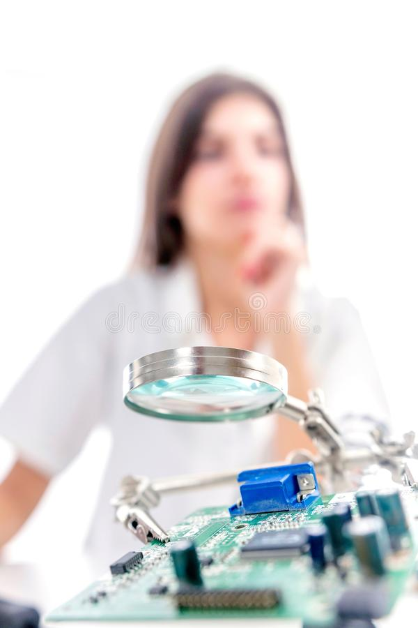 Woman Repairing Computer Part, Service Center, Electronics Repair Service stock photo